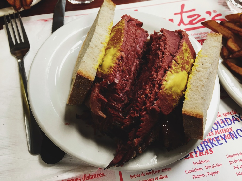 The legendary Montréal smoked meat sandwich from  Schwartz' Deli .