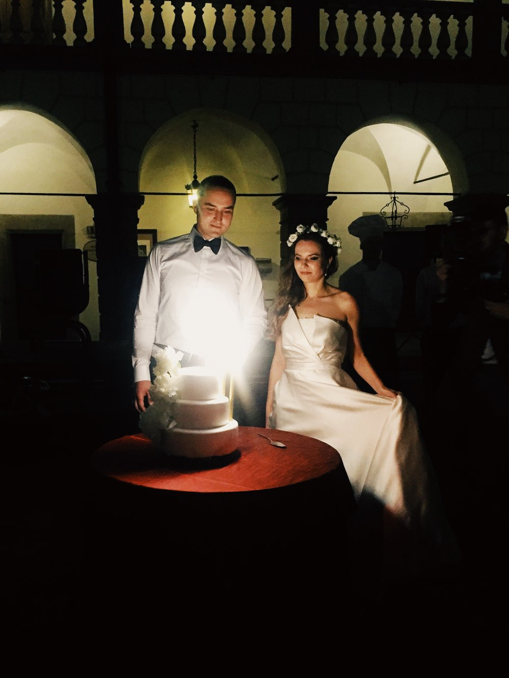 The beautiful bride and groom with their wedding cake.