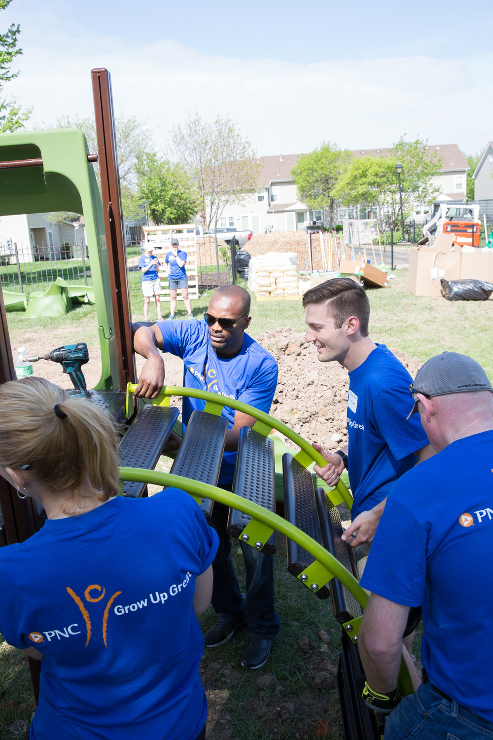 We host group volunteers like PNC and Isaac Bruce building our preschool playground (April 2017).