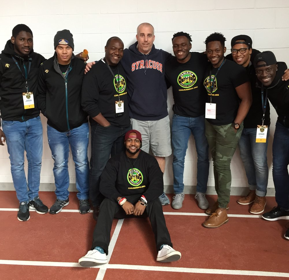 Boys Basketball Coach Jeff Ike poses with the Jamaican Bobsled team