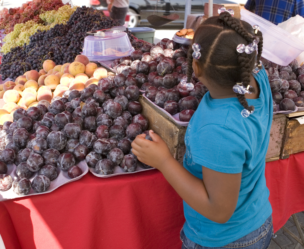 Child Farmers Market Plums