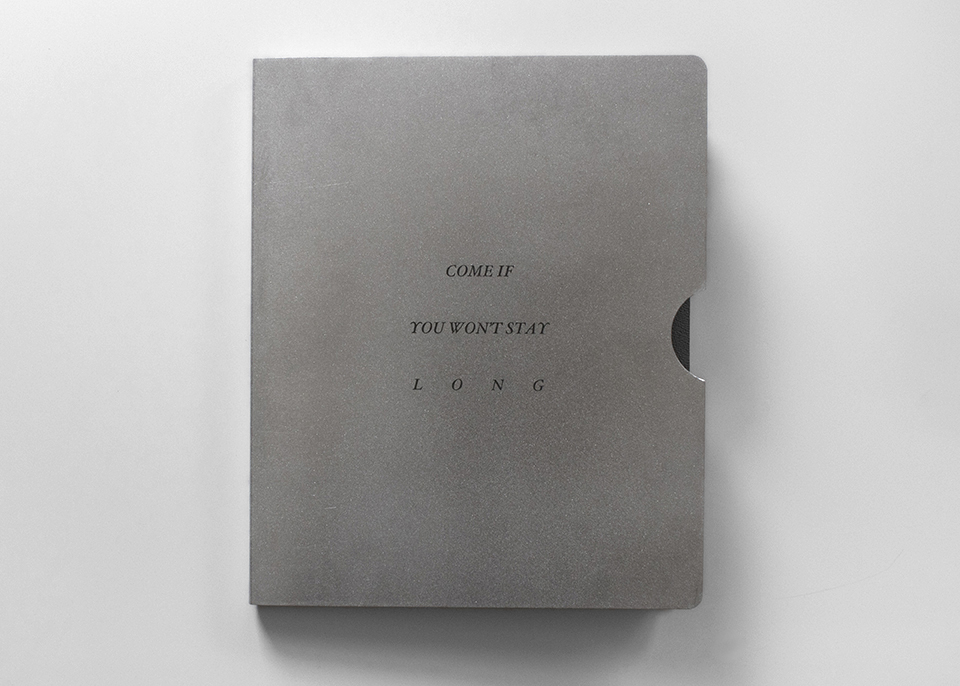"""Come If You Won't Stay Long, 2016, artist's book 11 1/2"""" x 9 1/2"""" x 1/2"""", ed. 40; litho on rubber cover, inkjet on polymer paper, aluminum slipcase, rain jacket made from TPU fabric 15"""" x 24"""""""