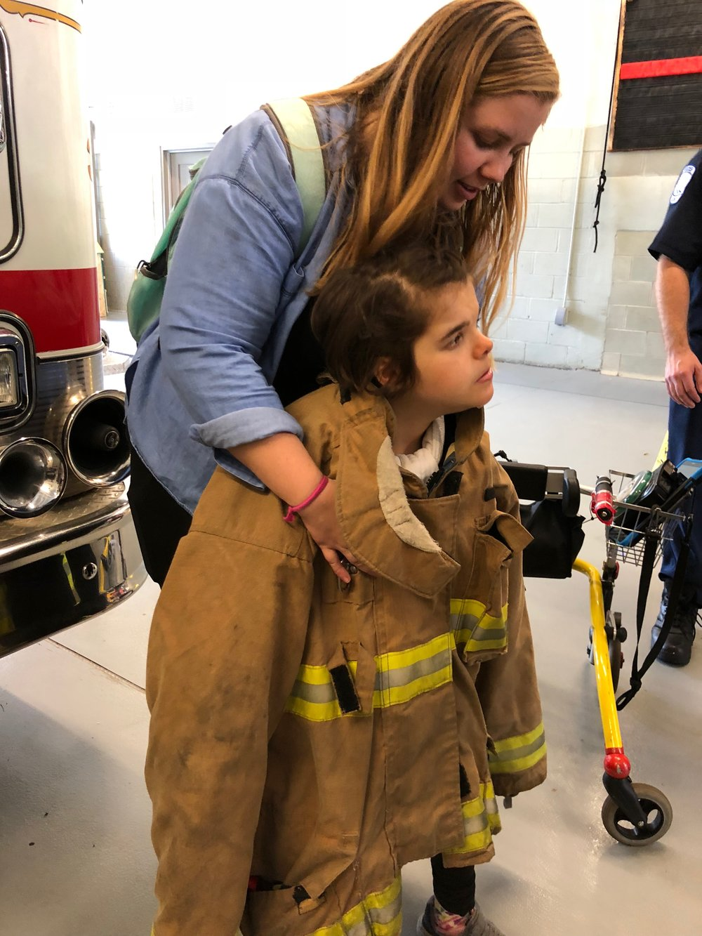 Adair with firefighter vest on.jpg