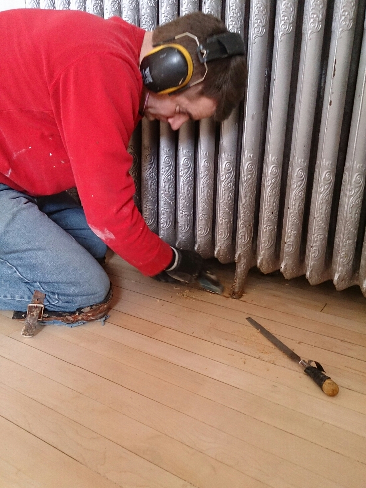 Vitaliy scraping under the radiator