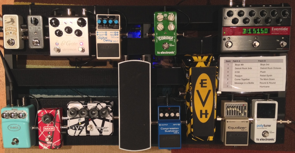 "The current pedalboard setup. The bottom row drives the ""front-end"", the top row drives the ""back-end"""