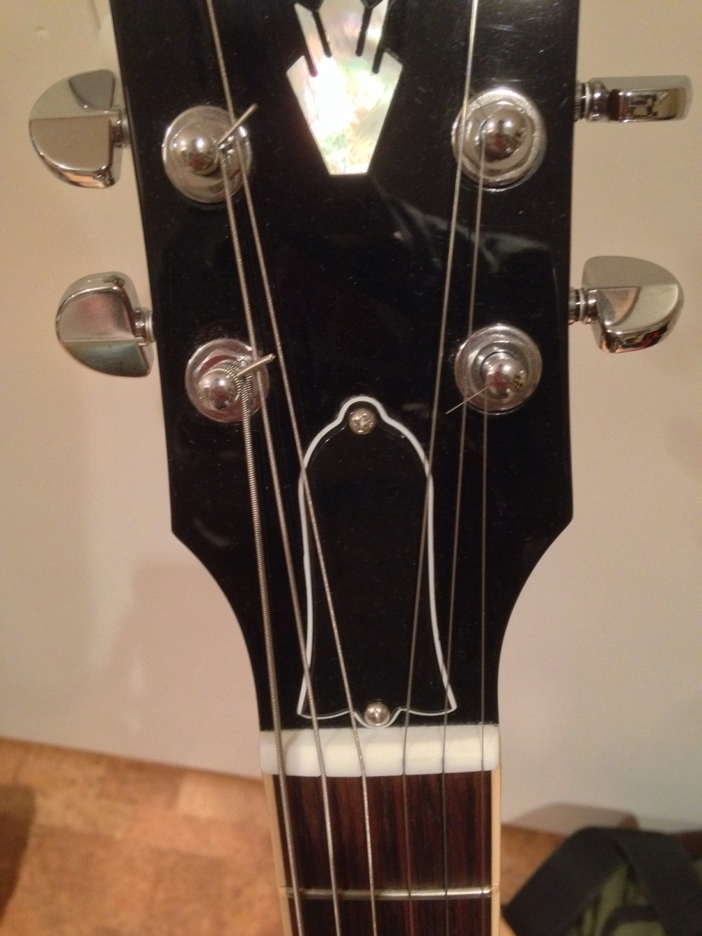 Gibsons require you to unscrew a cover-plate to get to the truss-rod bolt.