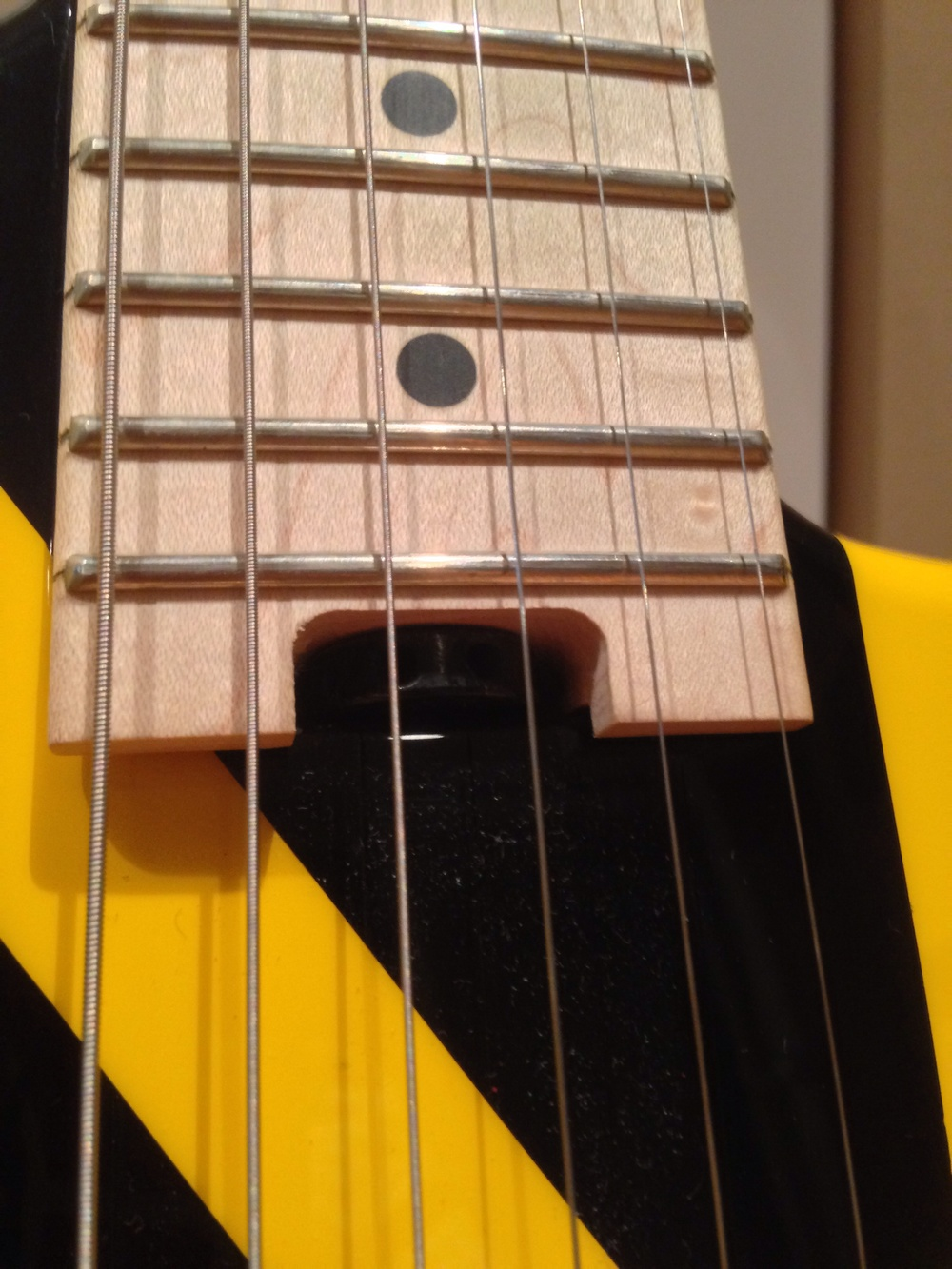 "EVH guitars use a ""wheel"" design at the base of the neck. You can stick anything in the holes to rotate the wheel."