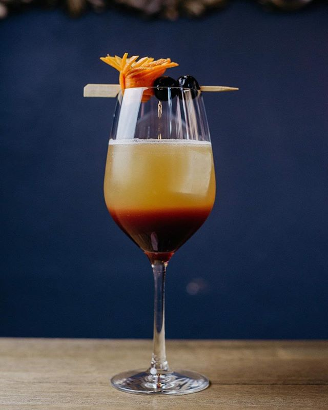 """Thirsty Thursday is here! """"MORRISON SOUR"""" •Woodford Reserve Bourbon •Grand Marnier orange liqueur •Lemon Juice •Honey •layer with LA MIRAJA- La Ribòta Aromatized wine an indigenous grape called Ruche from Asti Piemonte. •Garnish with an orange twist and Maraschinno cherries."""