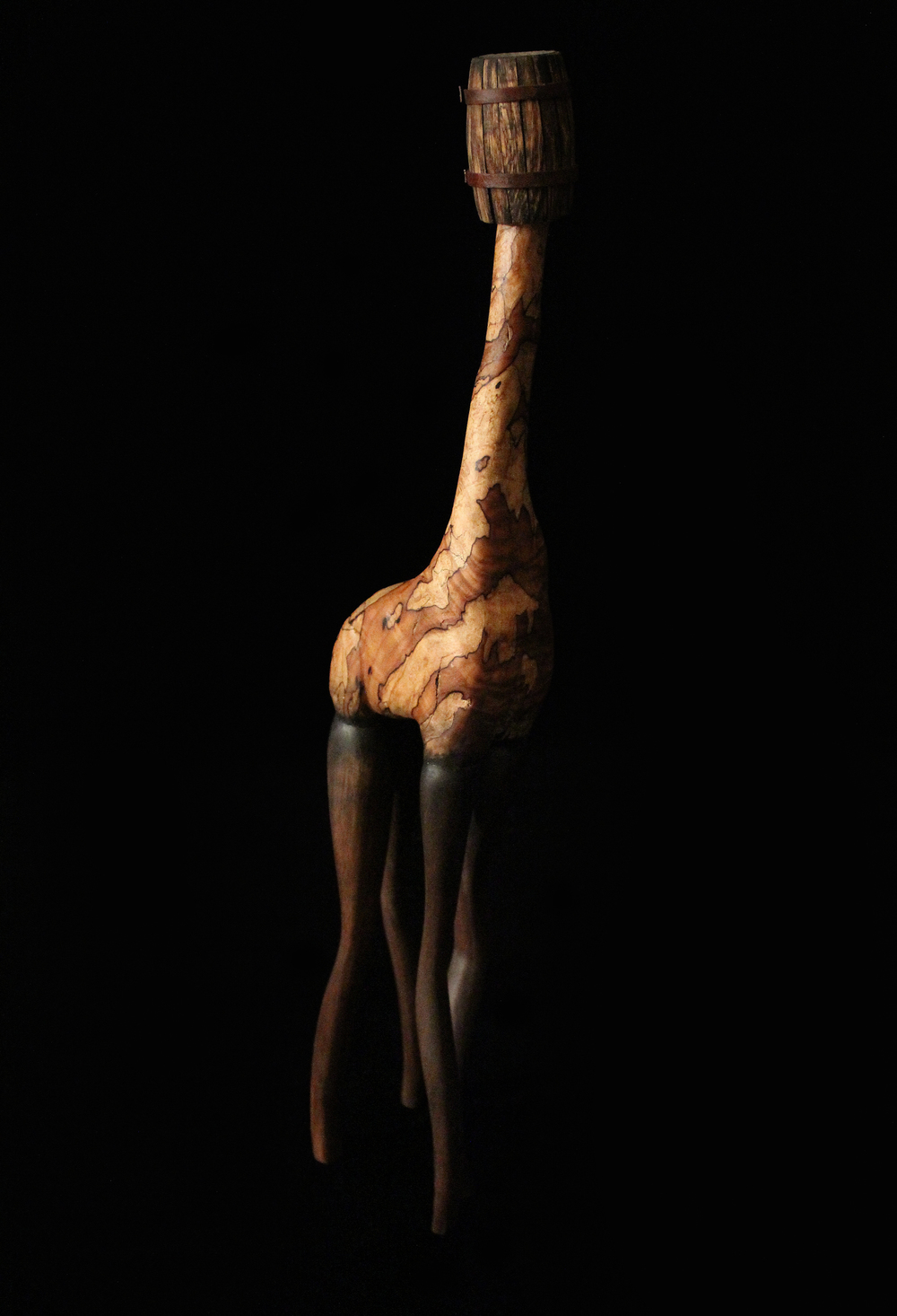 "Stand Tall, 2012. 21"" x 4.5"" x 3.5"" Carved Spalted Maple, Oak."