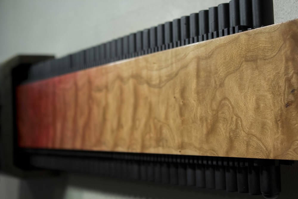 "Extraction (detail), 2016. 14"" x 48"" x 18"". Birch, cherry, figured Cherry, Oak, Poplar, Plywood."