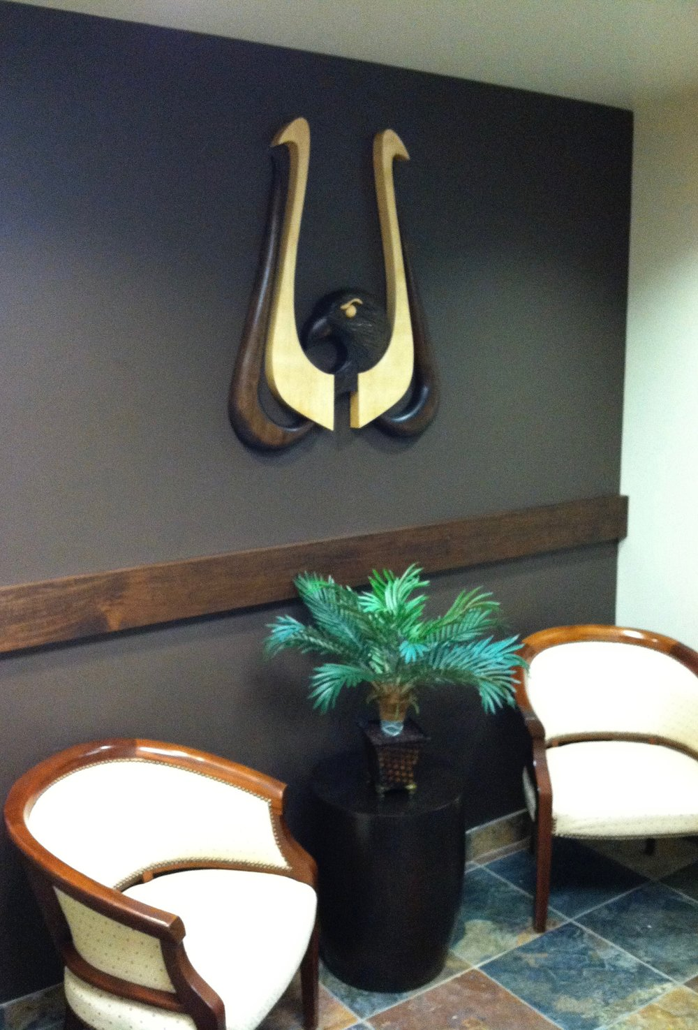 Wall mounted sculpture installed in corporate office.
