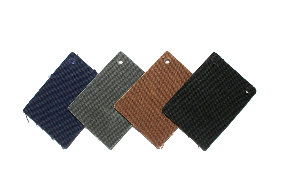 Waxed canvas shells are available in Navy, Charcoal, Brown and Black.
