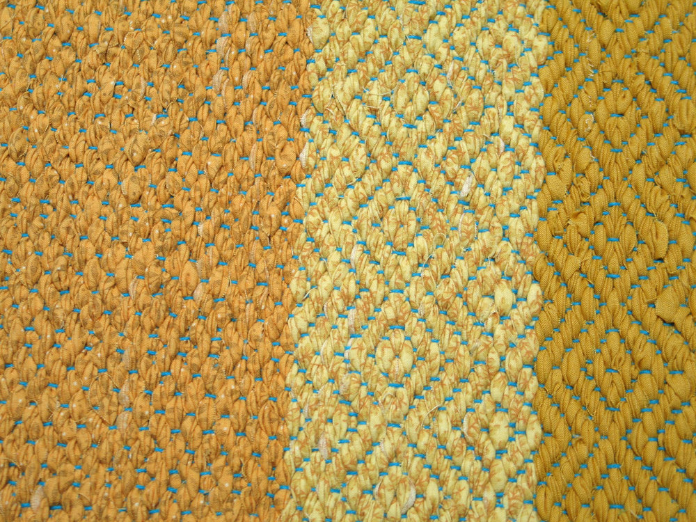 Woven cotton rag runner by Karen DeGeal. Used on Forms page.