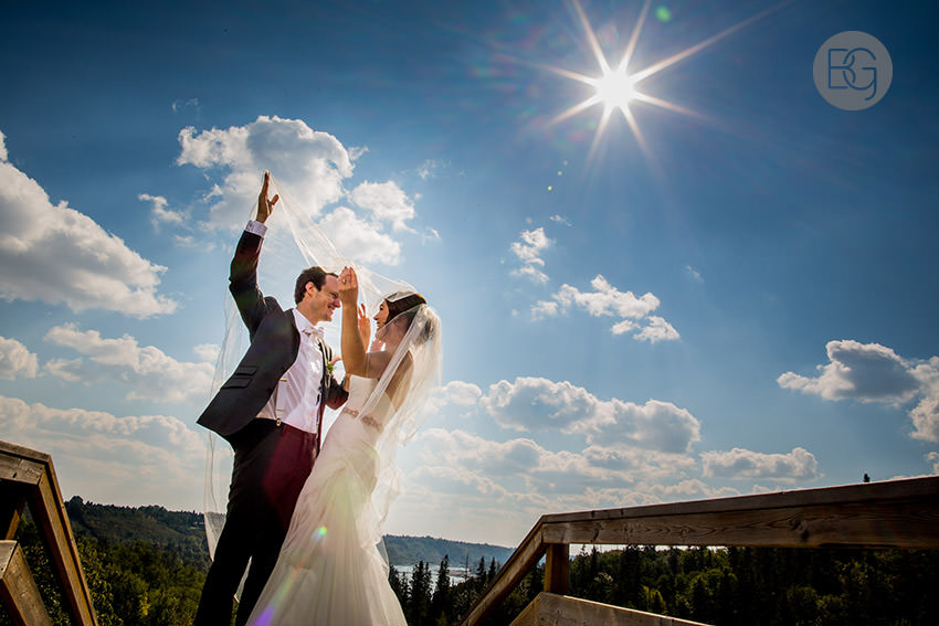 veil blowing edmonton wedding photographers summer sunshine river valley viewpoint amazing