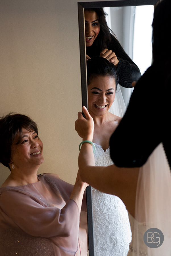 brides mom helping her get ready