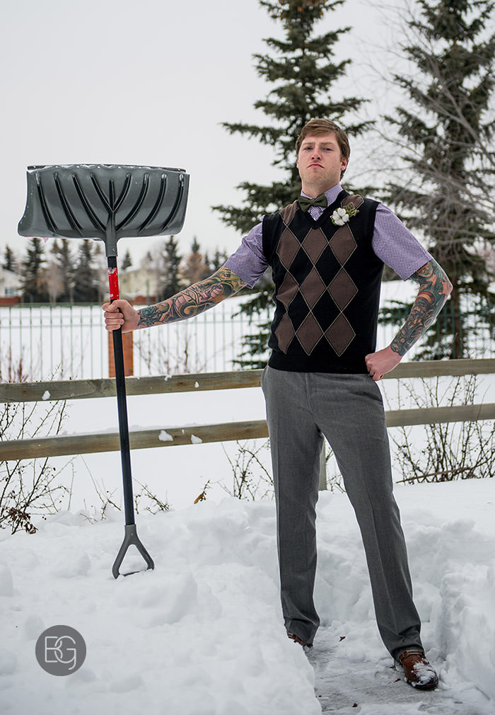 edmonton winter wedding photography snow shovel groom