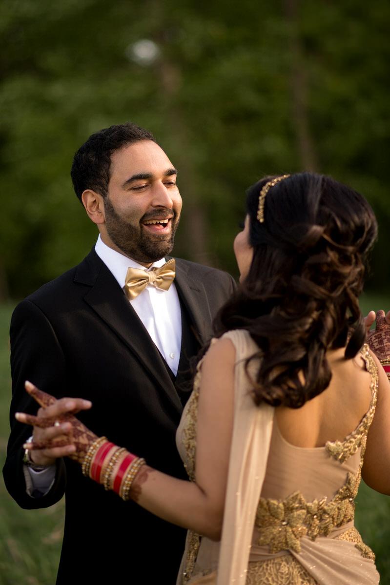 Wedding photography groom in gold tie tuxedo