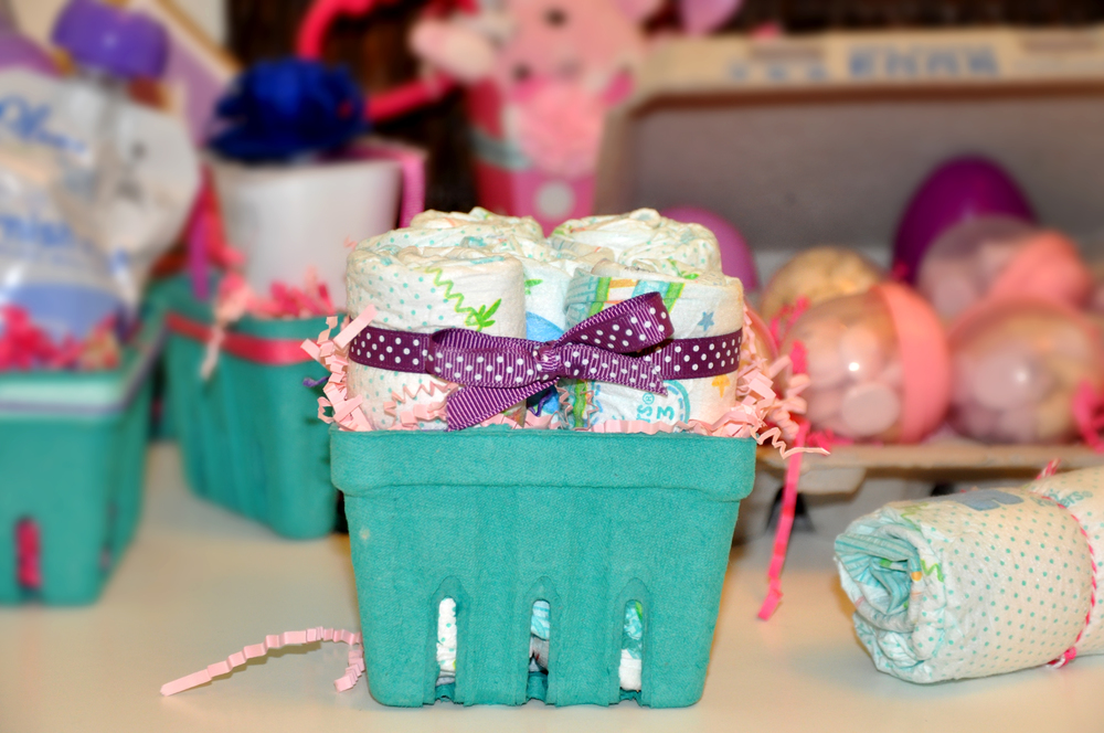 Adorable berry baskets filled with rolled and ribboned diapers!