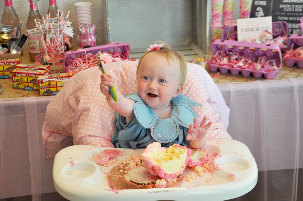 Seriously loving her smash cake! I used a cute blanket to cover an older not so cute highchair.