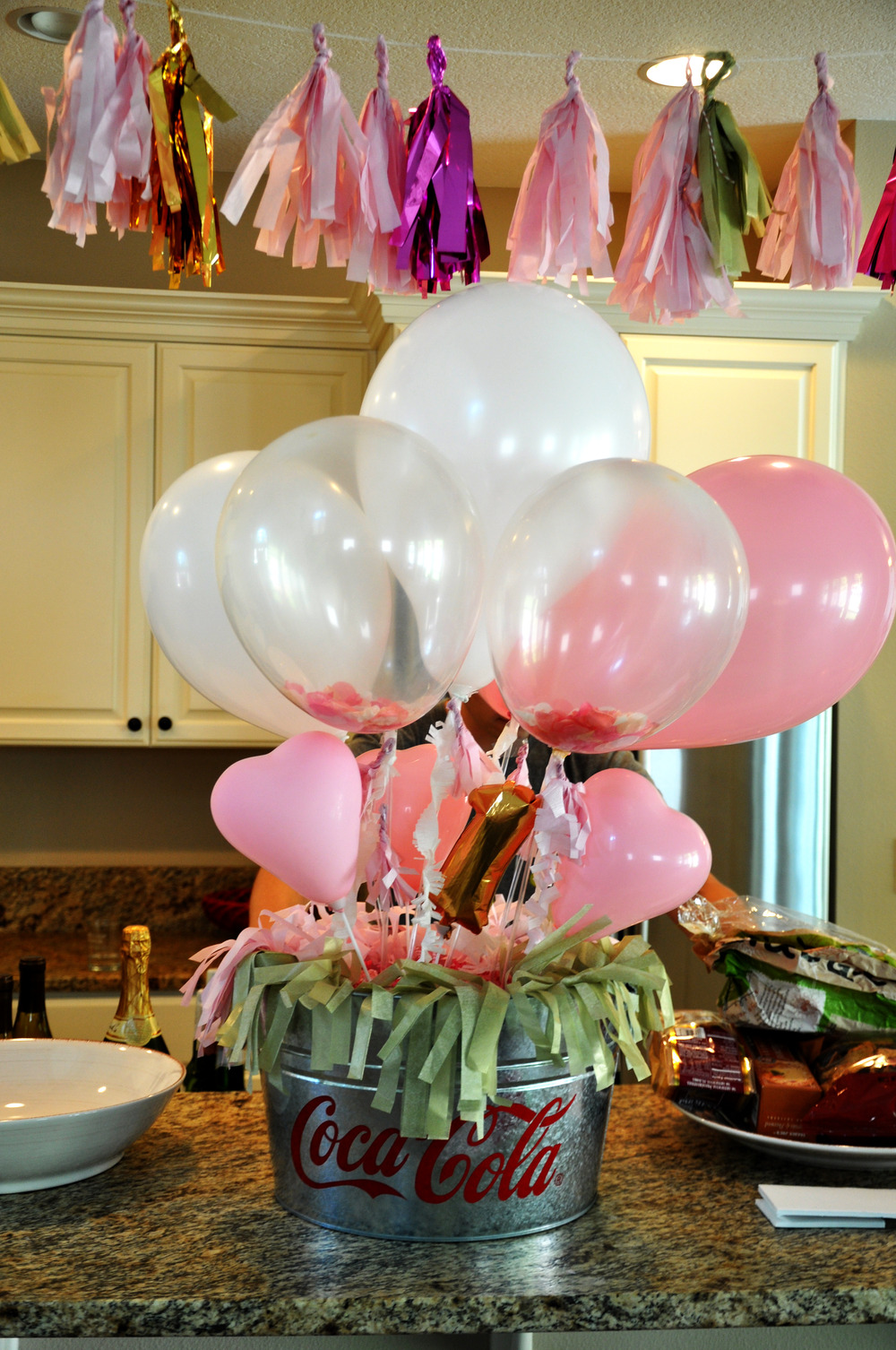 Balloon bouquet made with balloon sticks found at shopsweetlulus.com Clear balloons filled with tissue paper confetti also available at sweet lulus
