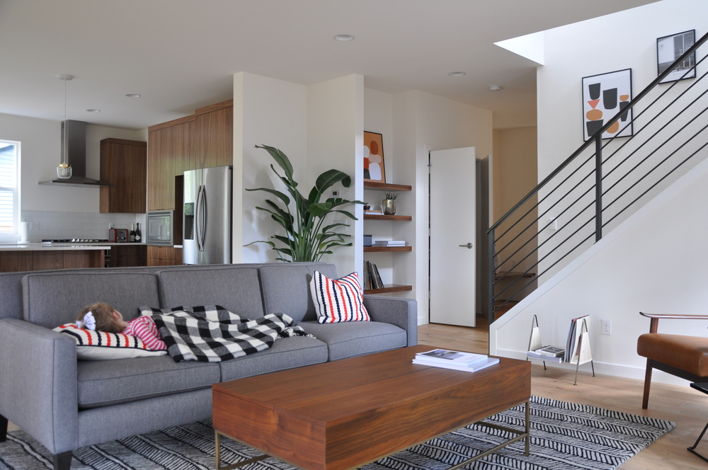 Sofa |Industrial Storage Coffee Table | Mid- Century Leather Chair | Herringbone Rug | Nautical Stripe Pillow | Buffalo Plaid Throw |