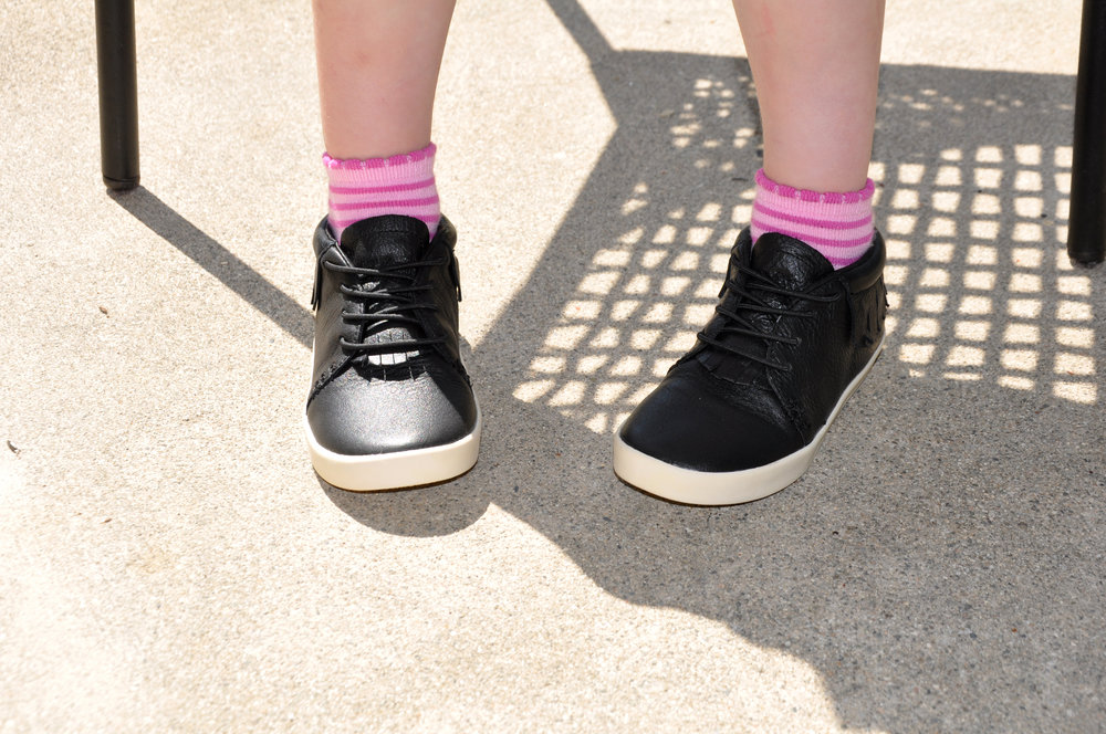 Have you tried the newest next step moccasins yet? The stretchy laces and sturdy rubber sole make for an easy-on, easy-off style that stays put on little feet. These have been great for preschool.