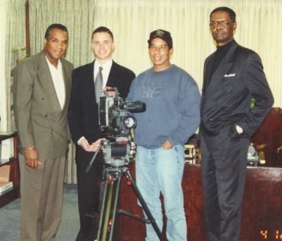 WHILE FILMING HIS INTERVIEW FOR FORT PILLOW, TENNESSEE CONGRESSMAN HAROLD FORD ( CENTER ) TAKES A PICTURE WITH FRED BANKS, STAN ARMSTRING, AND ARTHUR WEBB