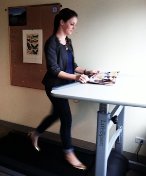 Emily Leaman of BeWellPhilly demonstrates the treadmill desk.
