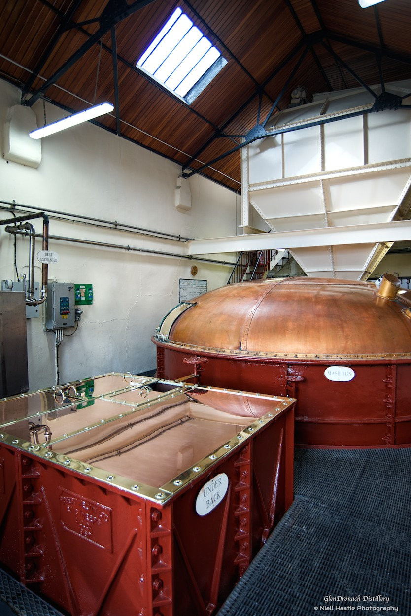 The 'Mash Tun' and 'Under Back'. The dried malt barley is ground down to grist in the Mill Room, then it passes through to the Mash House. This is where the starch in the grain is converted into liquid sugar or 'wort', which is what makes alcohol. The grist is mixed with three lots of water at increasingly high temperatures to leech out as much sugar as possible and maximise the yield of alcohol.