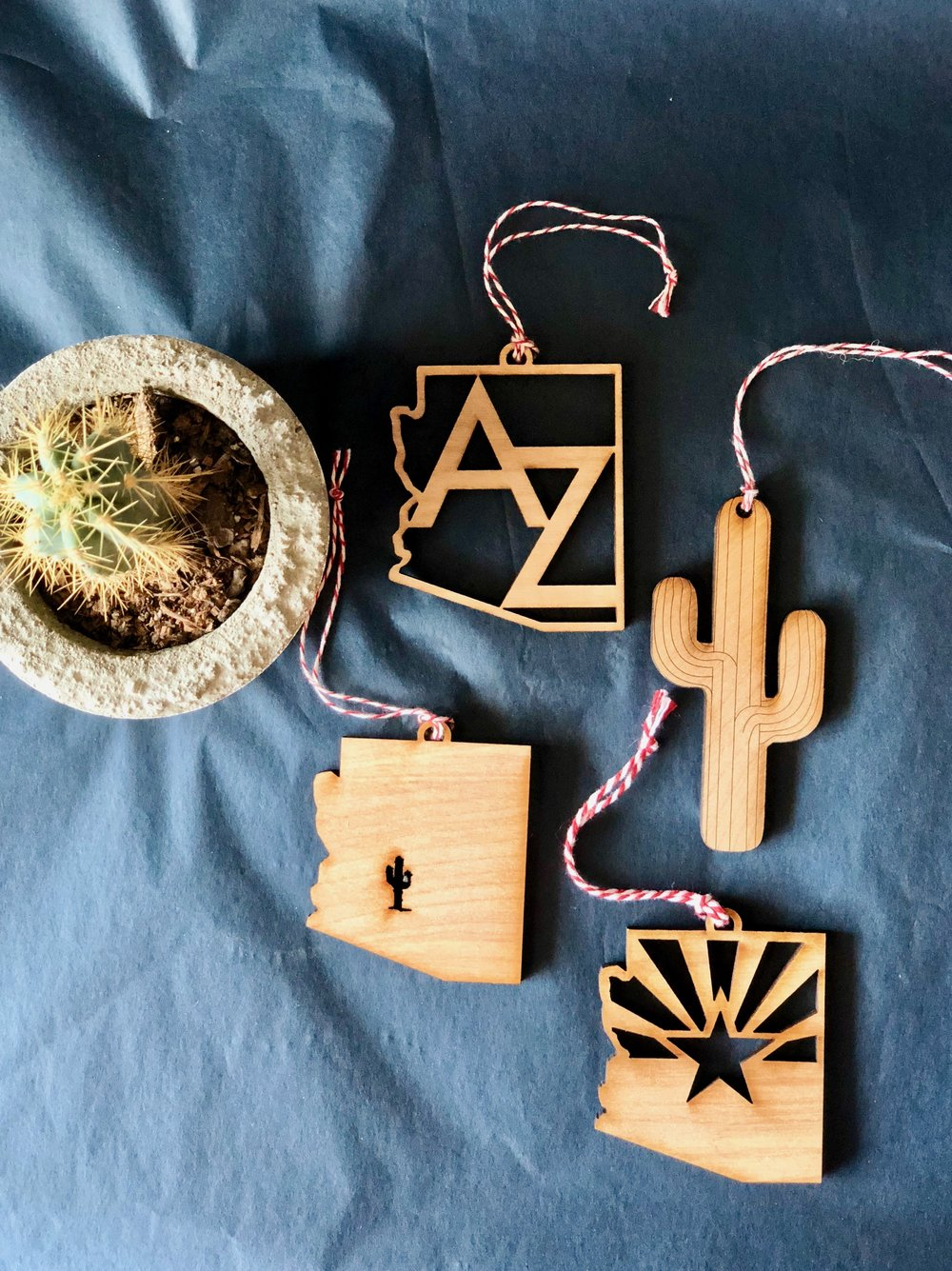 8. Wooden Arizona Ornaments  - Not just for the holidays. These unique wooden ornaments are available in a variety or AZ styles, and are made locally in Gilbert! We love leaving these for our guests, tying onto a gift bag, or tucking into our suitcase for ultra lightweight souvenirs. $10/each