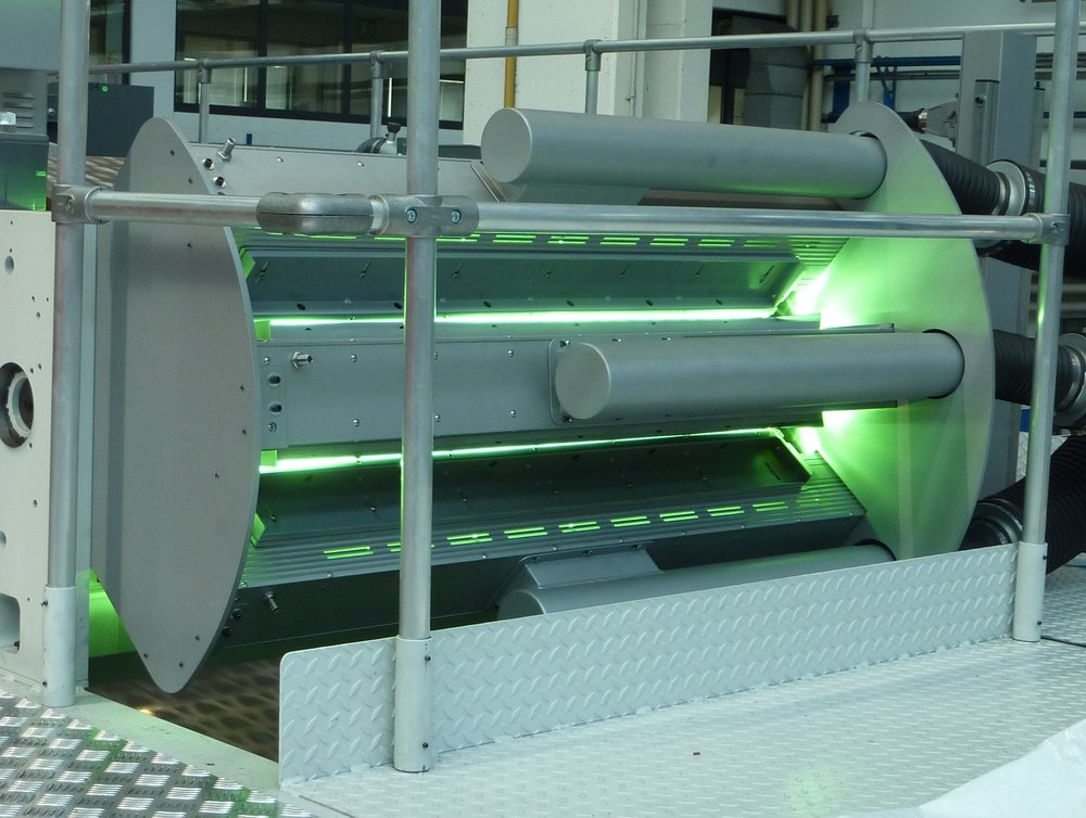 UV Lamps around chill roll after downstream coating station.