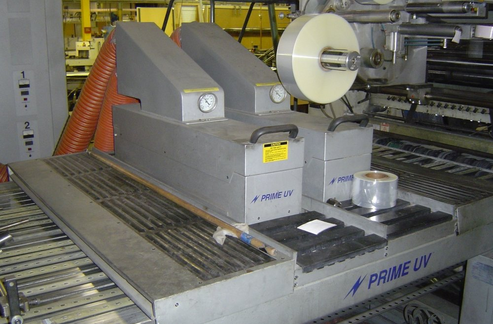 PRIME UV's  UV Conveyor System curing in-line with a Ryobi Sheetfed Press.