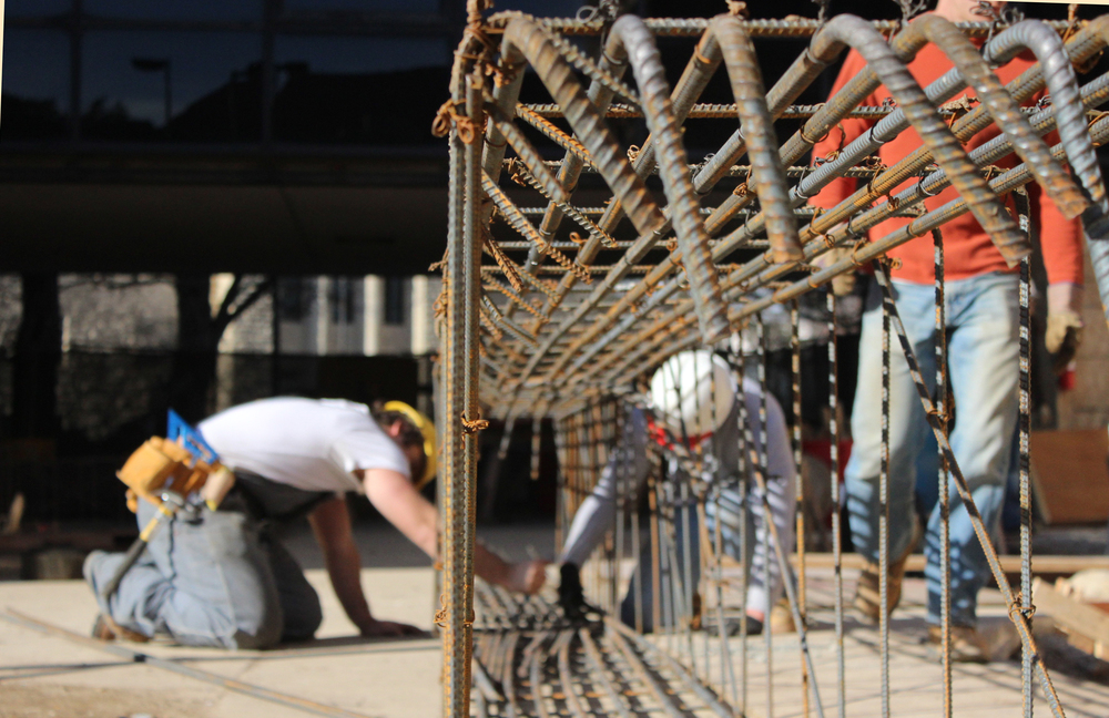 Studio 804 students learn by doing. Here students prepare reinforcing for a concrete pour. It was used to stiffen one of The Forum's grade beams.