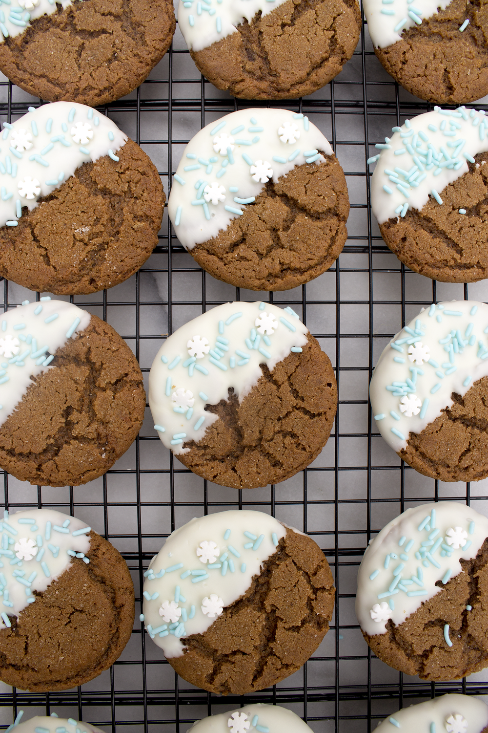 White Chocolate Dipped Spiced Molasses Cookies via Unusually Lovely