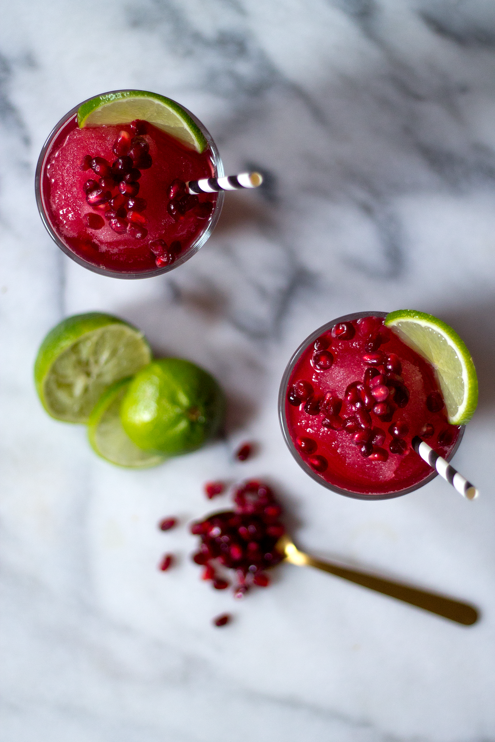 Pomegranate, Gin, and Lime Juice thrown into a blender. Unusually Lovely Blog