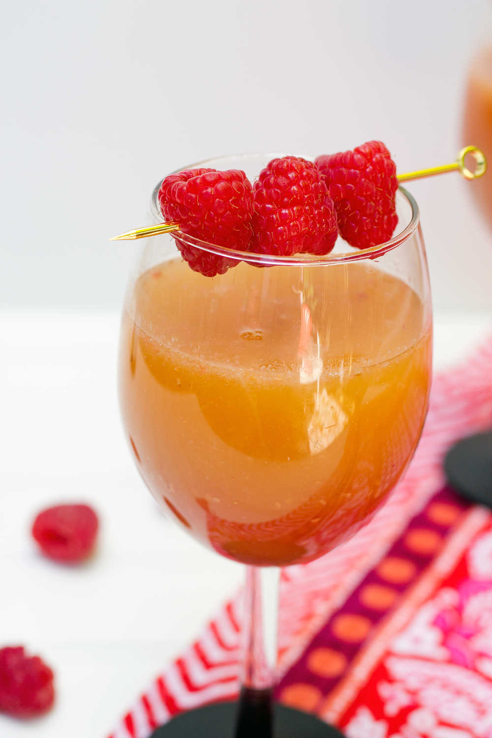 The perfect brunch cocktail: Raspberry Peach Bellini! Get the recipe from Unusuallylovely.com