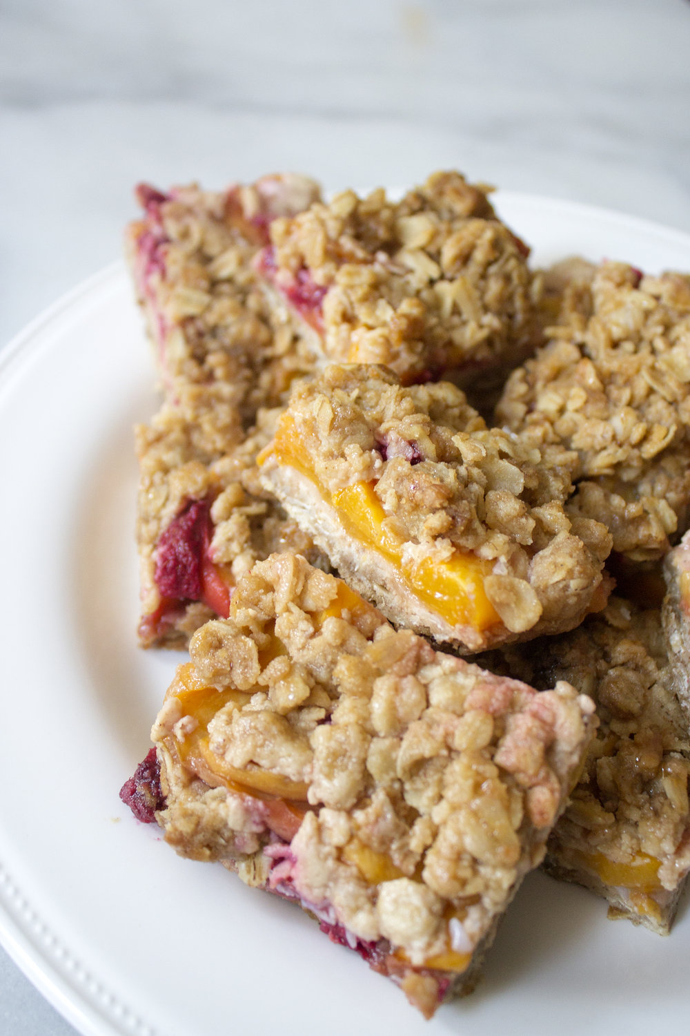 Crumb topped Peach and Raspberry Bars. Unusually Lovely Blog