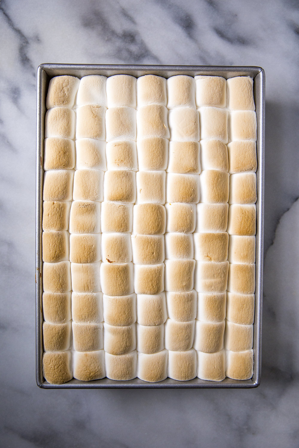 Pumpkin Sheet Cake topped with marshmallows. Get the recipe on the Unusually Lovely blog.