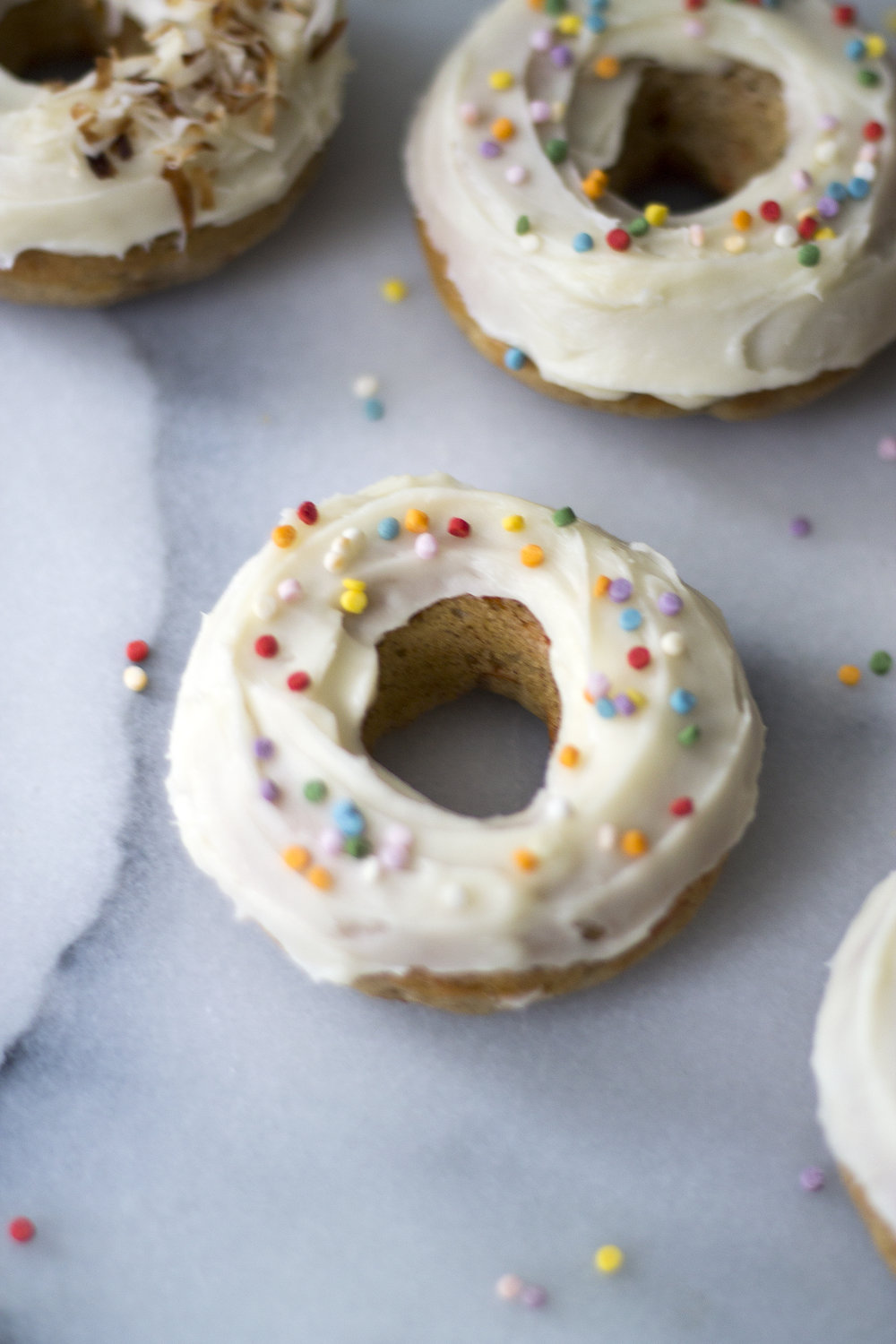 Topped with either toasted coconut or rainbow sprinkles, these Baked Carrot Cake Donuts are the perfect springtime treat. Get the recipe: unusuallylovely.com