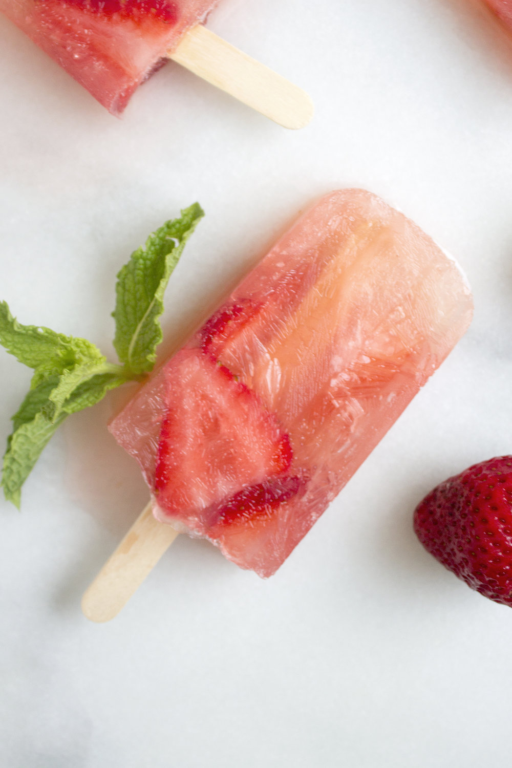 Strawberry Mojito Popsicles via the Unusually Lovely Blog