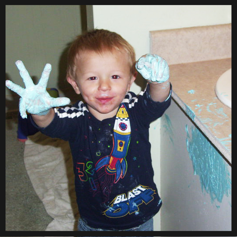 2 year old Logan decided to finger paint the bathroom with toothpaste!