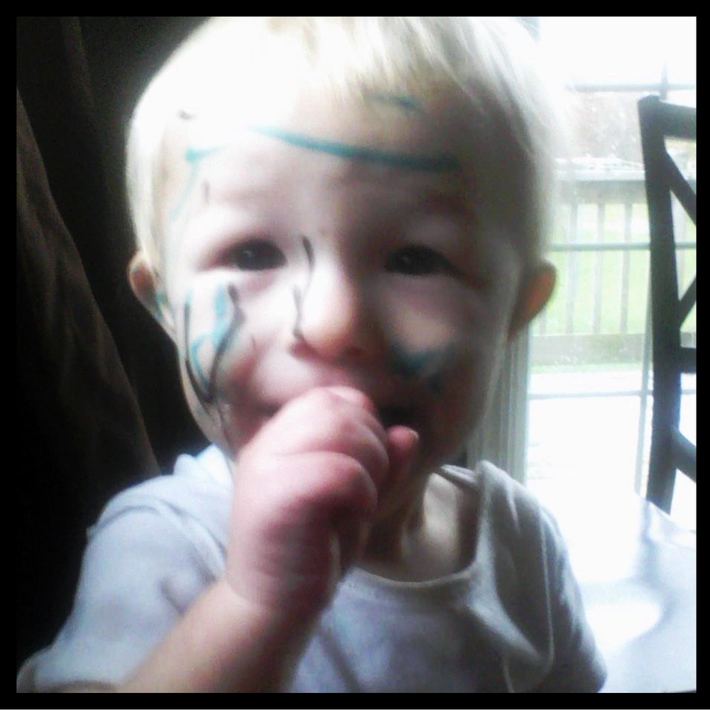 "2 year old Johnny and his sister had just come from a festival where they saw children having their faces painted.  Johnny's sister decided to join in on the fun...and ""painted"" her brother's face with permanent marker."
