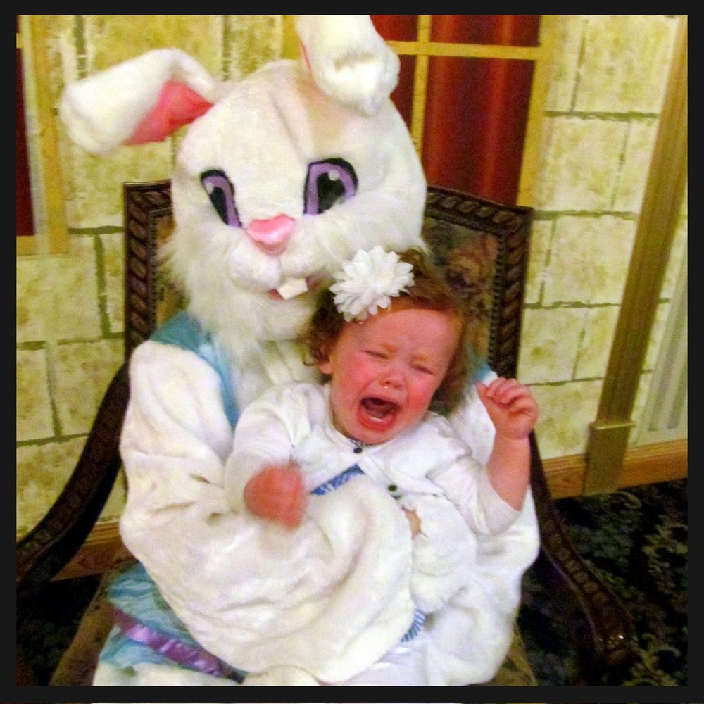 "Brynn ""enjoying"" her first trip to see the Easter bunny..."