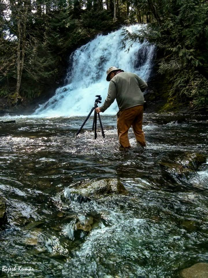 Mike_taking_photo_in_creek.jpg