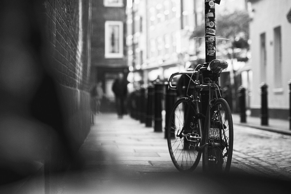 old bike chained up SOHO