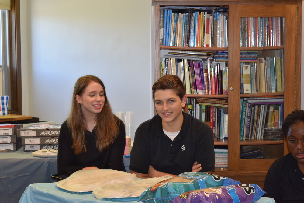 Elizabeth Renguette and Austin May help out in Campus Ministry