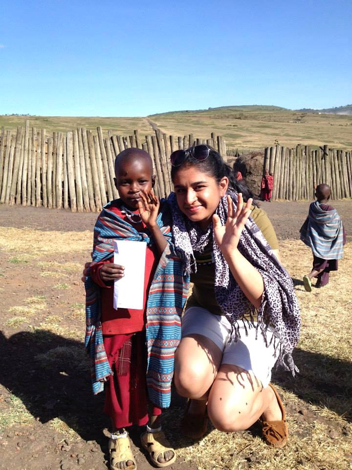 With a heart-crippled child from the Maasai tribe near the Ngorongoro Conservation Area, Tanzania