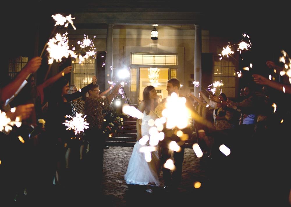 "I have to tell you, for this exit, there was a gentleman standing right in the middle of the isle for most of it! The videographer and I kept saying, ""excuse me! excuse me! clear the isle please!"" Exits are fast, you know! Finally, he stepped to the side, and I kind of love his big sparkler right in front of me. Sometimes what I think is an error, turns out pretty great."