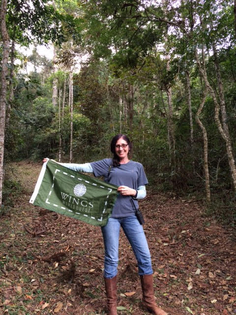 Dr. Karen Strier in Atlantic Forest with WINGS Flag. Photo courtesy of Karen Strier.