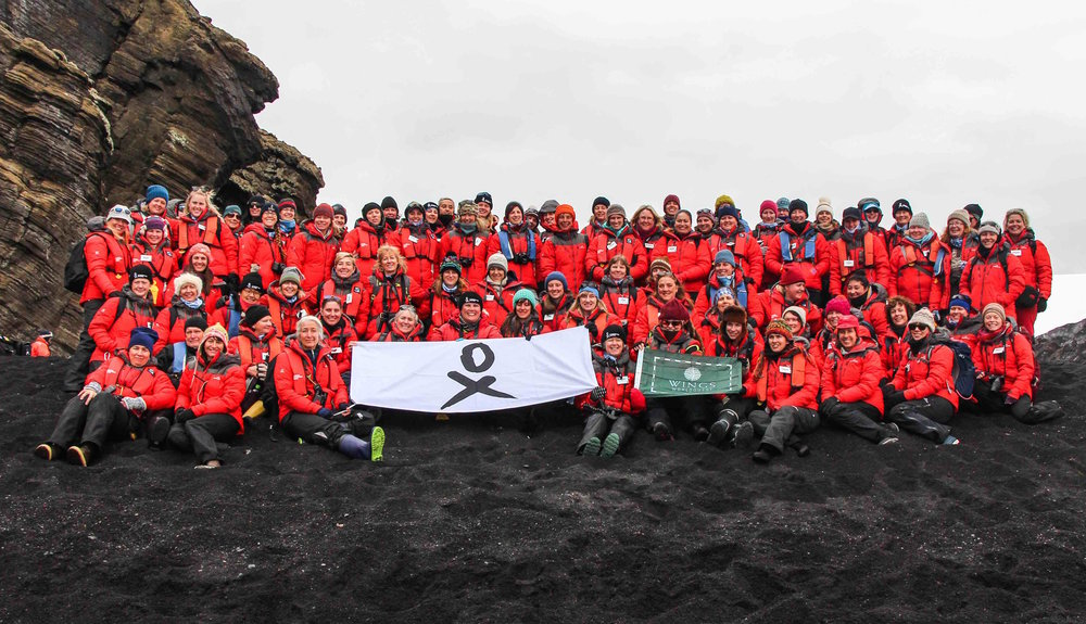 The Homeward Bound team with the WINGS WorldQuest Flag. Photo courtesy of Homeward Bound.